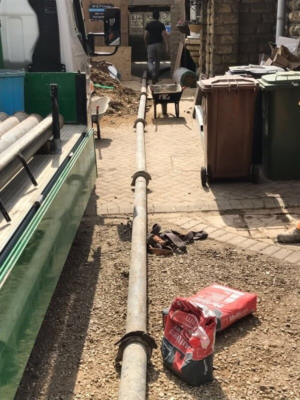 concrete pump pipe going indoors