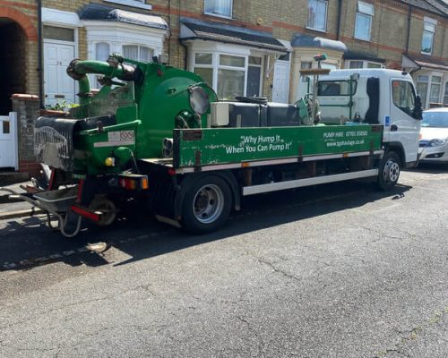 concrete pumping hire truck outside house in peterborough